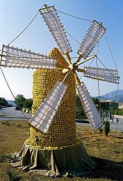 Windmill made of citrus fruit erected on the edge of a beach, Orange Festival, Soller, Majorca, Balearic Islands, Spain, Europe