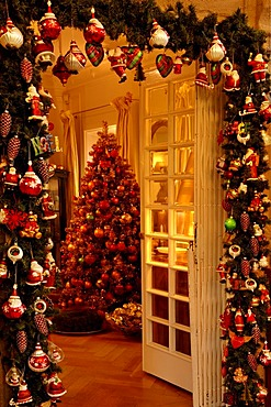 Christmas decoration, entrance in Christmas adornment with view to decorated Christmas tree in Villa Ambiente, Nuremberg, Middle Franconia, Bavaria, Germany, Europe