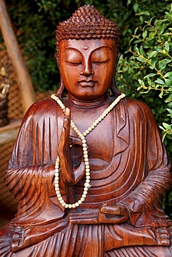 Buddha figure wearing a necklace at a garden exhibition, Wachenroth, Middle Franconia, Bavaria, Germany, Europe