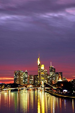 Skyline just after sunset with offices and high rise in the banking district, pink sky with grey clouds over Frankfurt am Main, Hessen, Germany, Europe