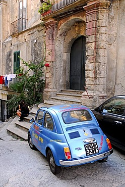 Blue Fiat 500 in the historic centre of Tropea, Vibo Valentia, Calabria, South Italy, Europe