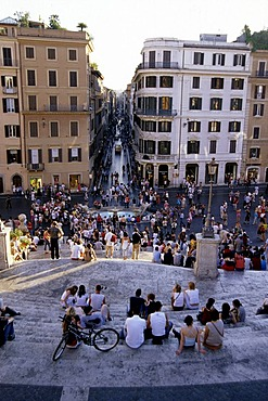 People populating Spanish Steps, Piazza di Spagna, Scalinata della Trinita dei Monti, view from above of the Via dei Condotti, Rome, Italy, Spain, Europe