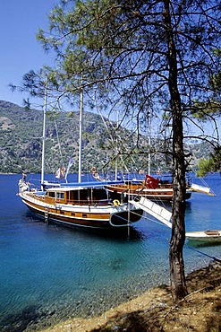 Cleopatra Hamami Bay, ancient bathing resort, yachts in the Bay of Fethiye, Mugla Province, Mediterranean, Turkey