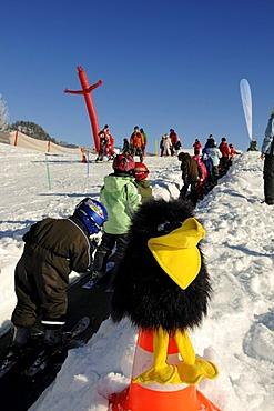 Skiing school for children Walchsee Lake, ski region Zahmer Kaiser, Tyrol, Austria, Europe