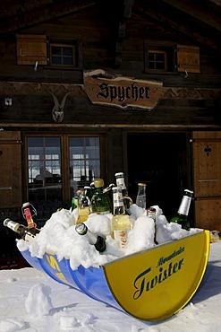 Chilled drinks at the alpine hut Spycher on the Mt Maennlichen, Grindelwald, Bernese Alps, Switzerland, Europe