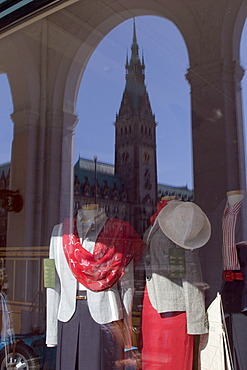 Fashion store in the arcades with woman's clothing and a reflection of the City Hall tower, Hamburg, Germany, Europe