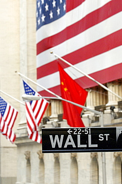 Wall Street, street sign in front of American flags, New York Stock Exchange, Financial District, Manhattan, New York City, NYC, New York, United States of America, USA
