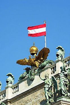 Imperial double-headed eagle with the Austrian flag on the roof of the National Library, Hofburg, Vienna, Austria, Europe