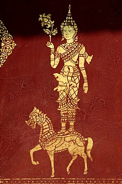 Gold color buddist figure on red background, Tempel Wat Saen, Luang, Prabang, Laos, South Asia