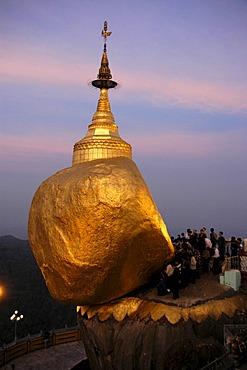 Buddhist sacred site, worshipers performing their morning prayers, Kyaiktiyo Pagoda or Golden Rock Stupa, Burma, Myanmar, Southeast Asia