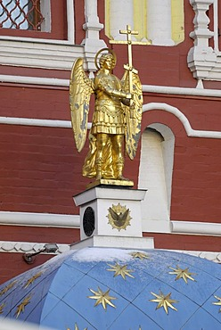 Sculpture of the golden angel holding a cross on top of the dome near Krasnaya Square, Red Square, Moscow, Russia