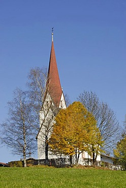 Romanic church on a hill, surrounded by autumnal trees, Kleinsoell, Tyrol, Austria, Europe