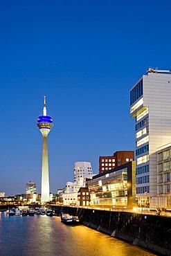 Rheinturm Tower, Frank O. Gehry buildings, Media Harbour, Duesseldorf, North Rhine-Westphalia, Germany, Europe