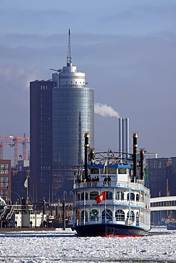 Paddle wheel steamer, Louisiana Star, in winter in the icy waters of the Elbe River in front of HafenCity with the Hanseatic Trade Centre, Hamburg harbour, Hamburg, Germany, Europe