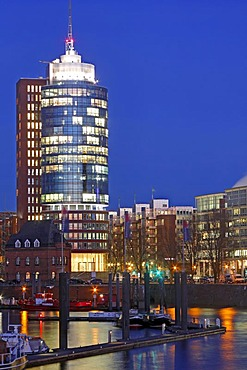 Illuminated tower of Hanseatic Trade Center HTC at night, HafenCity, Speicherstadt, old warehouse district, Kehrwiederspitze, port of Hamburg, Germany, Europe