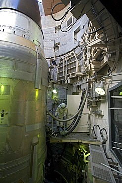 A Titan II missile in its underground silo at the Titan Missile Museum, a mannequin dressed in a protective suit is shown in a position to fuel the missile, Sahuarita, Arizona, USA