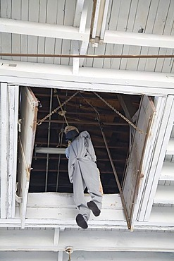 A dummy hangs where condemned prisoners were hanged at the West Virginia Penitentiary before an electric chair was installed; the prison was constructed in 1866 and closed in 1995 after a court ruled that the prison's 5x7-foot cells were cruel and unusual