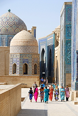 Colourful dressed women necropolis Shah-i-Zinda Samarkand Uzbekistan