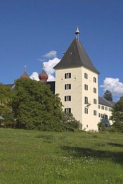 Millstatt at lake Millstatt Carinthia Kaernten Austria former Benedictine monastery founded in the 11. C. by the Bavarian Aribonen dynasty tower of the monastery out of the parks near the lake