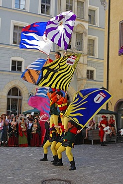 Regensburg Ratisbon Oberpfalz Bavaria Germany Buergerfest in the historic center flag threwing sbandiatori in front of the old city hall