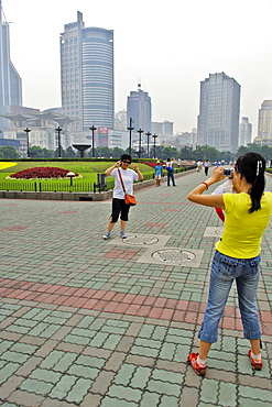 Public park, skyscrapers, chinese take some photos, Shanghai, China, Asia