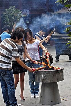 People lighting joss sticks, Yuyuan Garden, Shanghai, China, Asia