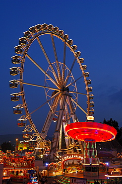 Ferris wheel and swing carousel at a fair in Stuttgart, Baden-Wuerttemberg, Germany, Europe