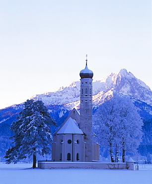 St. Coloman pilgrimage church under snow near Fuessen, Allgaeu, Bavaria, Germany, Europe