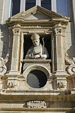 House front, priest, Valencia, Spain