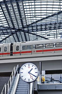 Station clock and ICE train, main station, Berlin, Germany