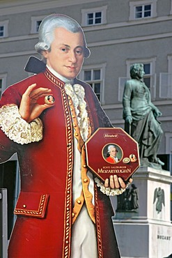 Advertising for the Salzburger Mozartkugel with a portrat of Mozart made of cardboard in the background the memorial of Mozart on the Mozart square town of Salzburg Austria