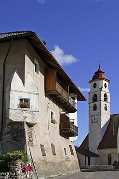 Old house and the church inaugurated to the saints of Ulrich and Wolfgang, Deutschnofen, Eggen valley, South Tyrol, Italy