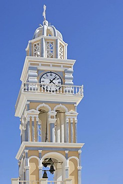 Tower with clock at the church Ag Ioannis Baptistis, Thira, Santorini, Greece