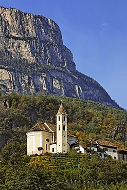 Village of Missian with church behind the mountain Gantkofel, near Bozen, South Tyrol, Italy