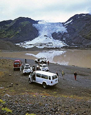 Four wheel drive cars and a glacier lake behind the Gigjoekull glacier, Thorsmoerk, Iceland