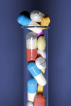Tablets and pills in a test-tube