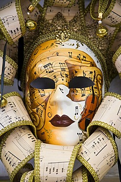 Venetian mask with notes and music motif, Venice, Veneto, Italy, Europe