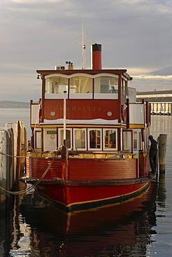 Boat illuminated by warm morning light in the harbor of Hobart, Tasmania, Australia