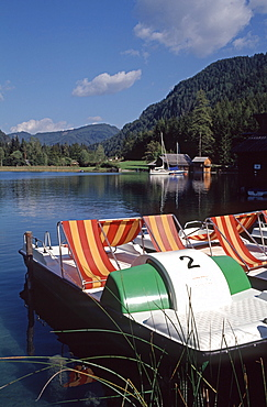 Paddle boats on the eastern shore of Lake Weissensee, Carinthia, Austria, Europe