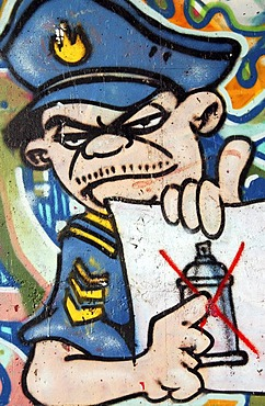 Graffiti prohibited ! Police officer shows the sprayed ban, Germany