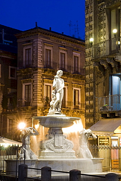 Fountain illuminated at night, Piazza del Duomo, Catania, Sicily, Italy