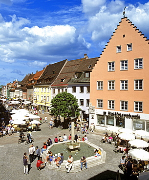 Fuessen at the Lech, city view, pedestrian area and well, Allgaeu, Bavaria, Germany