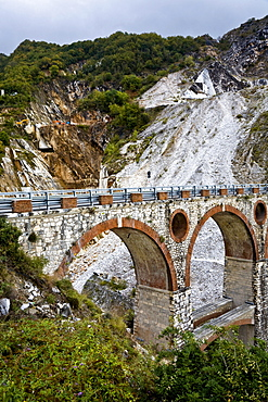 Stone bridge in the marble stone pit of Carrara Tuscany Italy