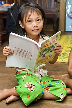 Portrait of a girl with school book, Koh Kong Province, Cambodia
