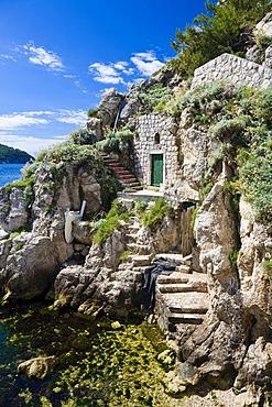 Old dwellings cut into the rocks near the historic city centre of Dubrovnik, Ragusa, Dubrovnik-Neretva, Dalmatia, Croatia, Europe