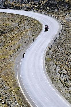 Mountainbikers descending an S-curve, Downhill Biking, Deathroad, Altiplano, La Paz, Bolivia, South America