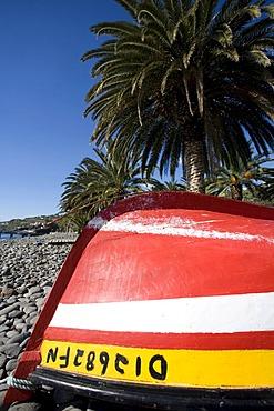 A fishing boat on the beach, Santa Cruz, Madeira, Portuga
