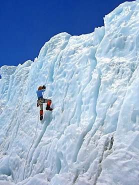 Female climber with crampons on a rope in lower Khumbu Icefall, Base Camp, 5300m, Mount Everest, Himalaya, Nepal