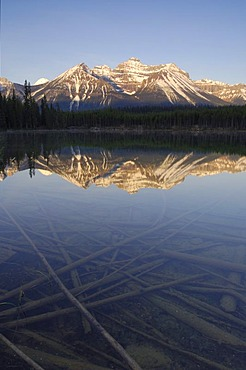 Sunrise on the Bow Range and crystal clear Herbert Lake, Banff National Park, Alberta, Canada
