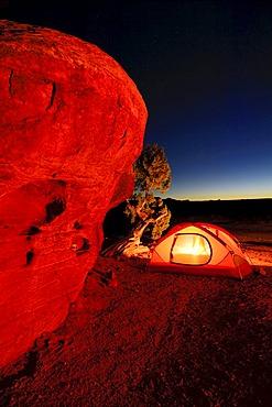 Camp at night with illuminated tent, Canyonlands National Park, Utah, USA